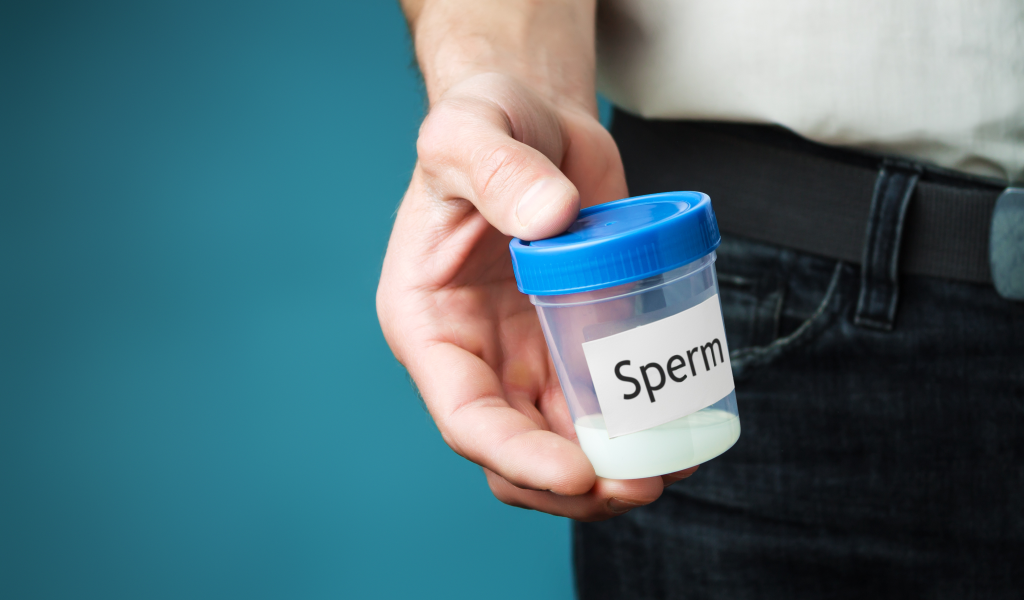 Man holding a sperm count test sample.